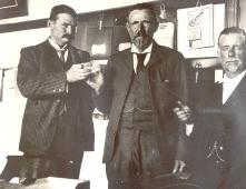 Publicity photo of the Cullinan crystal being handed from Fred Wells (right)to McHardy, who then hands it to Sir Thomas Cullinan (left). 1905