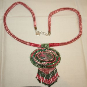 1 Thulite. Emeralds. gemstone. cabochon. beads. beaded. bead embroidery. green. pink. crystal. Swarovski. necklace. pendant. beadwork