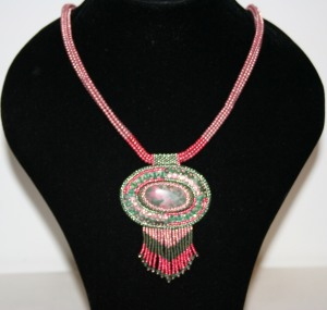 8 Thulite. Emeralds. gemstone. cabochon. beads. beaded. bead embroidery. green. pink. crystal. Swarovski. necklace. pendant. beadwork