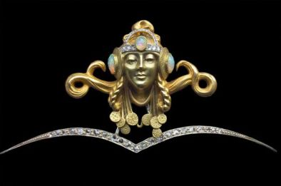 Art nouveau diadem of a Byzantine princess. It is French; made of gold, opal, and diamonds; c.1900. Unmarked, it is attributed to Fouquet or Vever.