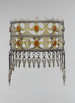 Crown, late 19th–early 20th century. Central Asia or Iran. Silver, fire-gilded and chased, with openwork, table-cut carnelians, wire chains, and embossed pendants.